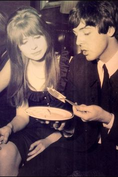 Jane and Paul - it looks like Paul is trying to eat a slice of American processed cheese with a fork.  ???