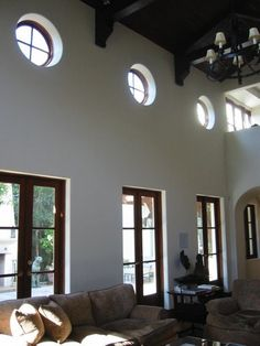 Spanish style home with round clerestory windows...