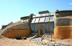 Phoenix Earthship Kitchen, these houses are amazin! they use alot of recycled materials to build them and the are completely self sufficient.