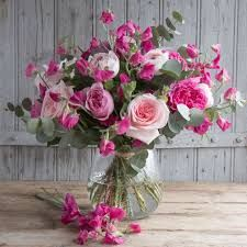 A bouquet that combines gloriously scented roses in three shades of pink with fragrant pink sweet peas, lovingly grown on sustainable flower farms and hand-tied by expert florists. Happy Flowers, Real Flowers, Sweet Pea Bouquet, Flower Company, Flower Farm, Pretty In Pink, Floral Wreath, Wreaths, Rose