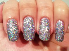 SolarClub Festival - a holographic glitter polish that changes colour in sunlight. Indoors (this pin): silvery lilac holo glitter. Outdoors: deep purple holo glitter. Click the image for more!