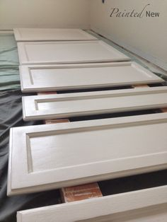Painted cabinet makeover, using Sherwin Williams White Duck. Includes step by step instructions and which materials to buy for best results!