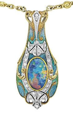 Pendant detail: Tiffany & Co. Art Nouveau necklace with a gold, enamel, and black opal pendant on a peridot and white opal-studded gold chain. Circa 1900. @vintageclothin.com