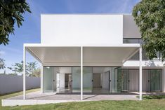A stark white palette is used both outside and in this Brazilian home, designed by local firm Bloco Arquitetos as a series of angular volumes. Minimalist Home Decor, Minimalist Living, Residential Architecture, Architecture Design, Galley Style Kitchen, Minimalist Architecture, Ground Floor Plan, House Built, Shades Of White