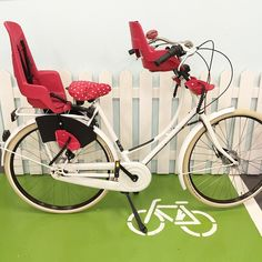 This is the kind of child transportation on 2 wheels you can do. Red and white with a little bit of polka dots for fun! White Oma with bobike maxi and mini, basil bell and seat cover. www.urkai.com #citybike #childtransportation #colour