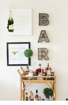 Want to add a bar cart to your home but don't know where to start? You've come to the right place! Bar carts are a huge trend that we are certainly on board with, but it can be hard to find out exactly what to add to your bar cart or how to even start… Home Bar Decor, Bar Cart Decor, Target Home Decor, Ikea Bar Cart, Diy Bar Cart, Pub Decor, Passion Deco, Gold Bar Cart, College House