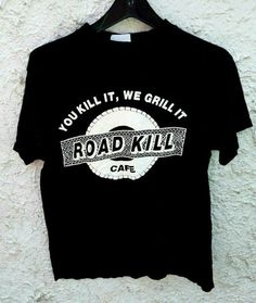 Authentic vintage Road Kill Cafe You Kill It We Grill It t shirt. Issued on the TC Tour Champ tag. Size large on tag but will fit adult medium only. Chest is across and the length is Shirt looks great! Vintage Cafe, Vintage Shirts, Vintage Outfits, Vintage Fashion, Newport Blue, College Shirts, Old Shirts, 90s Fashion, Vintage Looks