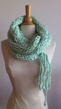 Puce goes XL - Light green round scarf with bow, knit in t-shirt yarn.