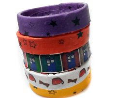 Resin bangle bracelets decopauged with fabric scraps.