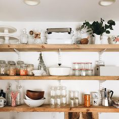 Open shelving in the kitchen -- loved that they used the Elfa system here!