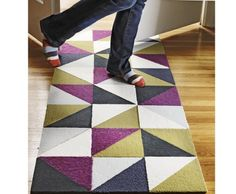 Cut carpet tiles to make a geometric rug.