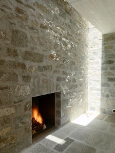 Fireplace with natural lighting inside Weski de Meuron's Brione House.