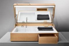 Hidden è un contenitore lavabo da appoggio con integrati rubinetteria in acciaio inox, specchio con led, specchio ingranditore, cassetto e presa corrente.