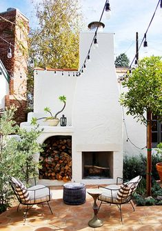 Spanish Colonial in Los Feliz - This patio by DISC Interiors conjures an Italian piazza with bistro lights strung overhead a pair o - Spanish Colonial Homes, Spanish Style Homes, Spanish House, Spanish Backyard, Spanish Bungalow, Spanish Revival Home, Outdoor Rooms, Outdoor Living, Outdoor Decor