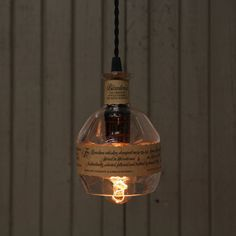This upcycled Blantons bottle pendant light has been handcrafted from a recycled Blantons bourbon bottle into an elegant pendant fixture. Blanton's Bourbon, Bourbon Gifts, Bourbon Barrel, Whiskey Bottle Crafts, Coffee Filter Art, Bottle Chandelier, Glass Ceiling Lights, Bottle Lights, Bottle Lamps