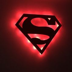 """Perfect for Superman fans and for children's play rooms or bedrooms. Some may even use this as a Superman night light! This wall cutout is precision machined with a CNC router out of 1/2"""" wood. It is then painted with blue edges and a red face. This unit has optional red or white LED lights. www.addictedfurnishings.com"""