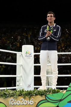 Silver medalist Sofiane Oumiha of France celebrates on the podium during the medal ceremony for the Men's Light (60kg) boxing event on Day 11 of the Rio 2016 Olympic Games at Riocentro - Pavilion 6 on August 16, 2016 in Rio de Janeiro, Brazil.