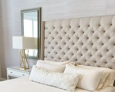 Bedrooms - Change out the wood headboard for a softer, more luxurious look