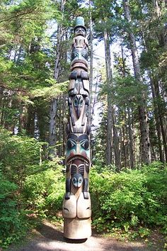 The Yaadas Crest Corner Pole, one of the many replica totem poles on display at the Sitka National Historical Park. The figures (from top to bottom) are: the Village Watchman, the Raven in Human Form, the Raven, and a Bear.