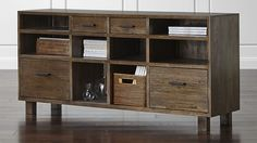 The Oak Park credenza shows its modern Prairie School heritage in the angular simplicity of its design and the organic look of solid chestnut. Stained a warm shade of grey-brown to amplify its natural grain, the credenza offers closed and open storage options for the office, library or living room.
