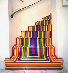 Architecture Art Designs rainbow stripe stairs...if you have stairs heres how to make your room fabulous.