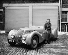 Miss Patten, Baroness Dorndorf, leans on her Peugeot in May 1939.
