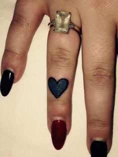Cute little love heart, finger tattoo done by Bob at rude studio