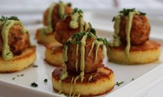 Polenta cakes topped with cheesy jalapeno poppers and avocado cream