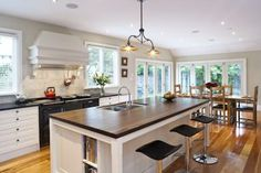 A Slice of England: The renovations done aimed to recreate the warmth of a European farmhouse kitchen. To ensure the space is functional and practical, the kitchen includes numerous drawers, shaped to suit their contents and including internal divisions and fittings, such as angled spice inserts, tray divisions and pull-out bins. Click the image for the full article. Pull Out Bin, Innovation, Kitchen Islands, Kitchen Designs, Contents, Modern, Table, Spice, Drawers