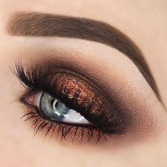 Bronzed smokey eye and sculpted brows.
