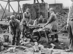 Women rebuilding. WW1 by G P Lewis  (MOI official photographer)
