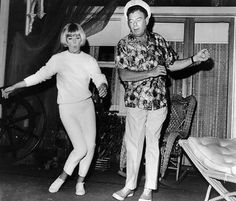 Dodo showing Arthur Godfrey how to swing it on the set of 'Glass Bottom Boat', 1966.
