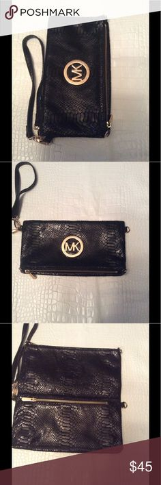 Mk clutch purse Preloved mk clutch interior can use a cleaning no crossbody strap just wrist strap otherwise good condition Michael Kors Bags Clutches & Wristlets
