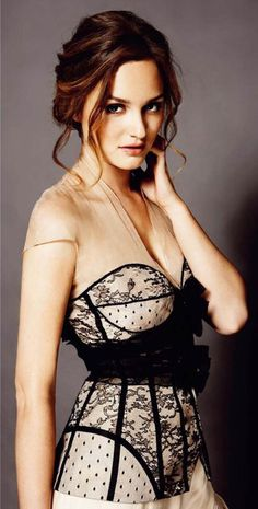 Leighton Meester, over dress lace corset.