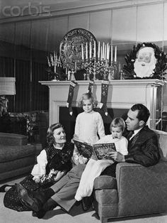 Vintage Christmas Photograph ~ Vice President-Elect Richard Nixon with wife Pat, six-year old Tricia and four-year old Julie at their home in Washington ©December 25, 1952