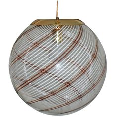 Large Italian Swirl Design Handblown Glass Globe Pendant Light | From a unique collection of antique and modern chandeliers and pendants  at https://www.1stdibs.com/furniture/lighting/chandeliers-pendant-lights/