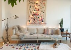 Gifts For Every Wanderer — inside Elsewhere   Travel Guides - Cool Beach Huts & Design Hotels, Stylish Restaurants - Bohemian Design Inspiration, World-Influenced, Rustic Eclectic Minimalist Sofa Moroccan Rug Cactus Living Room Decor Ideas