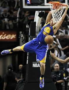 Golden State Warriors Klay Thompson (11) dunks against the San Antonio Spurs during the second half of Game 2 in their Western Conference semifinal NBA basketball playoff series, Wednesday, May 8, 2013, in San Antonio
