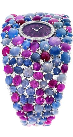 {DeLaneau's Grace Stars jewellery watch is set with 118 star-cut rubies and sapphires as well as 276 diamonds. The dial is a slice of ruby known as a ruby heart, surrounded by 58 diamonds.}