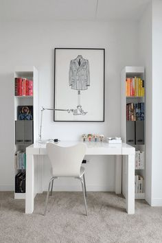 The Parsons Desk and simple shelving keep the office area looking sleek, while books and desk accessories add some pops of color.