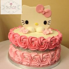 Hello Kitty birthday cake for a 40th birthday. Buttercream rosettes, buttercream frosting by Faye Adora Cakes.