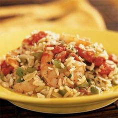 Low Country Shrimp Pilaf - canola oil - green bell pepper - onion - bottled minced garlic - Old Bay seasoning - shrimp - dry white wine - 8 oz. clam juice - instant white rice - fresh thyme - 14.5 oz. can diced tomatoes with jalapenos