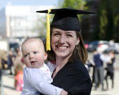 Emily Hratchian (and her baby Lucy) at UMSI graduation. Thanks Emily and Kristin Fontichiaro for the ID!