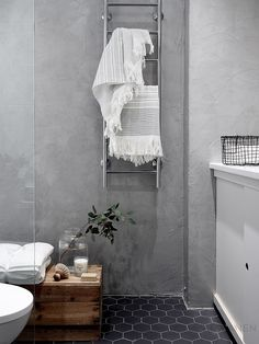 The wood cabinet helps warm things up a little while keeping with the minimalist aesthetic. Concrete wall in bathroom, interior design & styling by Laura Seppänen Bathroom Interior Design, Interior, Bathroom Wall Decor, Bathroom Styling, Contemporary Home Offices, Bathroom Design Styles, Concrete Bathroom, House Interior, Home Interior Design