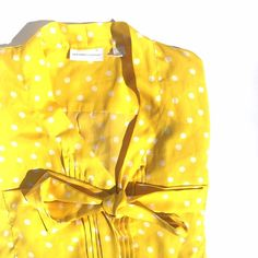Yellow polka dot bow blouse • New York & Company Perfect condition! So many great details in this top. Bow neckline. Pleating. Hidden buttons. Sleeves can be rolled and buttoned. Back is pleated for a very flattering fit. Make an offer, no trades :) don't forget to bundle and save! New York & Company Tops Button Down Shirts