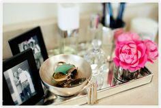 vanity tray with jewelry, perfume, roses and family photos