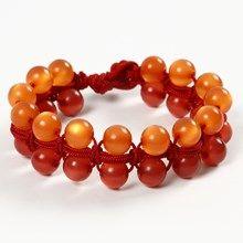 Knyttet armbånd med perler og glidelukning af knyttesnor