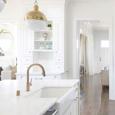 Kitchen Decor Ideas : Brass Kitchen Faucet and farmhouse sink. I love how much warmth brass can bring to a white kitchen! White kitchen with brass lighting brass faucet and brass hardware. Kitchen Interior, White Kitchen, White Kitchen Decor, Home, Farmhouse Sink, Brass Kitchen Faucet, White Kitchen Cabinets, Brass Kitchen, Kitchen Faucet Design