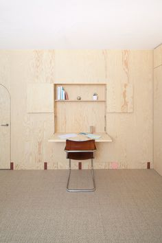 Fold out desk space Inhabited wooden walls in Geneva by Aurélie Monet Kasisi