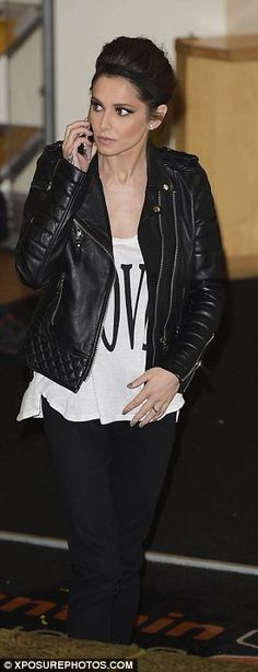 Concern? The 32-year-old was in a deep conversation on the phone as she left the X Factor ...